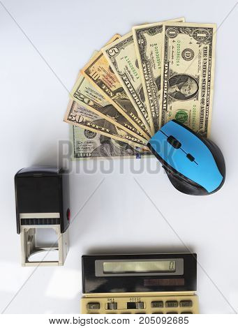 Business concept: computer mouse seal old calculator money located opposite each other on a white background