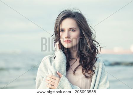 Portrait of a Beautiful Girl with Curly Hair on a Cold Windy Day Outdoors
