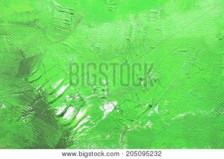 Canvas with oil paints green colors. Bright saturated abstract background space for text. The concept of a creative atmosphere artistic events education etc.