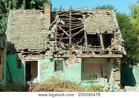 Small old and abandoned house demolished of the earthquake destruction