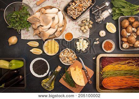Group Of Raw Ingredients For Preparing Vegetarian Dinner.oyster Mushrooms, Champignons, Honey Mushro