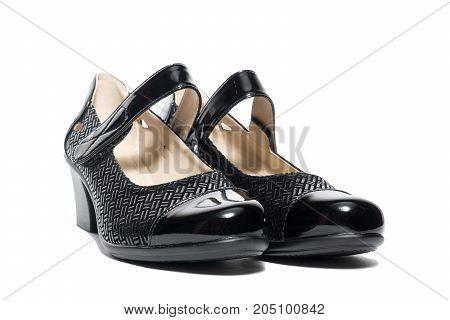 Black female shoes on a white background isolated studio