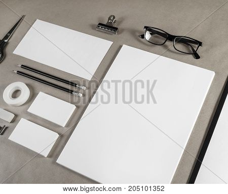 Photo of blank stationery and corporate identity template on craft paper background.