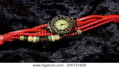 Wrist watch on a black velvet background