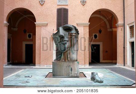 Rome, Italy - May 16, 2012: A contemporary sculpture by Polish artist Igor Mitoraj in a Roman courtyard, Rome, Italy