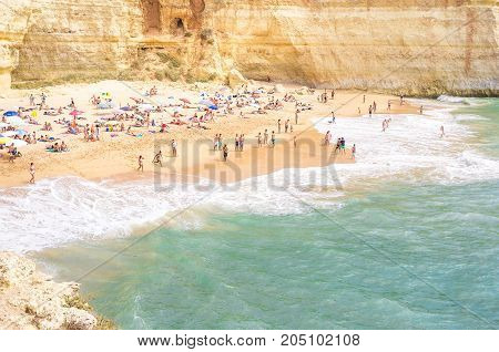 Sand beach full of people, Overcrowded beach by the sea, People by sea in Portugal, Dream holiday by sea, Tourists by sea on beach