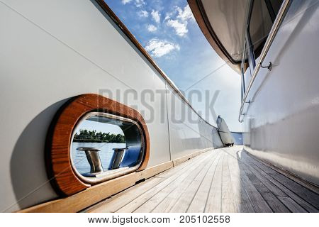 Fairlead and bollard on the deck of a luxury wooden yacht. walk around the ship.