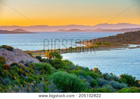 view of the gulf and the island of the Aegean Sea during a sunset