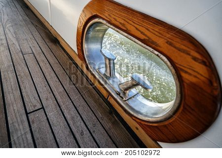 Fairlead and bollard on the deck of a luxury wooden yacht.