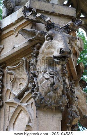Deer head sculpture detail outdoour architecture art