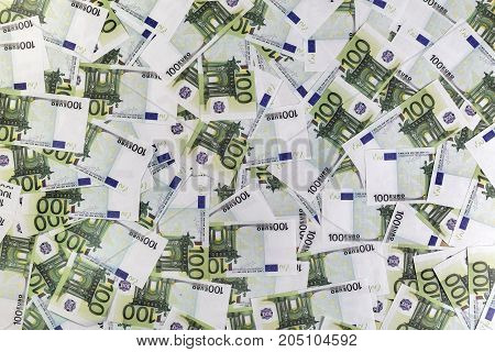 Pile of paper euro banknotes. Money as background. Top view.