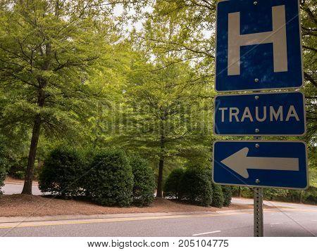 Hospital trauma traffic sign with arrow on road