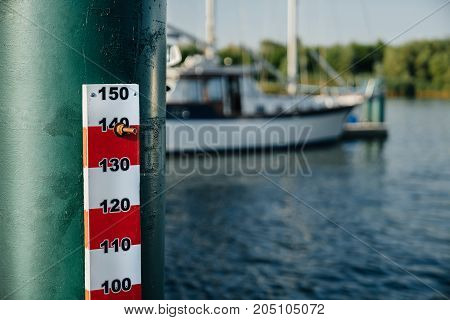 range of water level in the river on the background of the yacht.