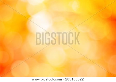 Blurred Golden Autumn Background. Colorful Bokeh Effect Background.