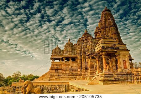 Beautiful image of Kandariya Mahadeva temple Khajuraho Madhyapradesh India with blue sky and fluffy clouds in the background It is worldwide famous ancient temples in India UNESCO world heritage site.