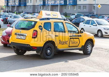 Samara Russia - September 17 2017: Yandex taxi at the city street in Samara Russia