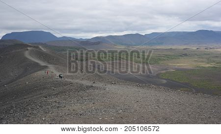 Walking along the edge of the Hverfjall crater and view of its sorrounding, Iceland