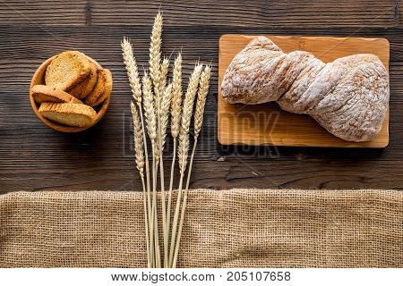bakery shop set with fresh wheaten bread on table rystic background top view
