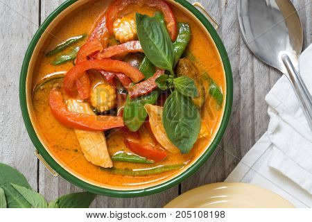 Red Thai Curry In A Bowl On Wooden Table