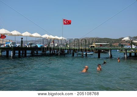 Marmaris, Turkey - August 16, 2017: Family enjoys water during summer holiday near jetty in Marmaris, Turkey