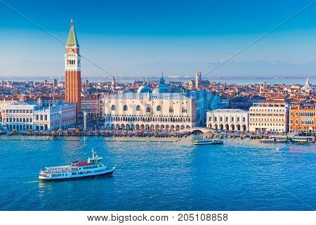 Venice cityscape Italy. Ship is floating in The Grand Canal of Venice. Aerial panorama of the most popular Italian city.