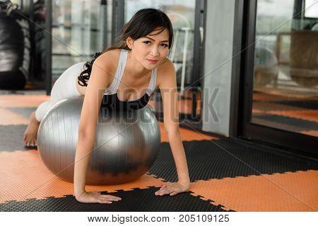 Asian Beautiful Woman Plank On Fitness Ball