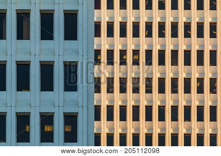 Composition of facades of two different office skyscrapers closeup Atlanta USA