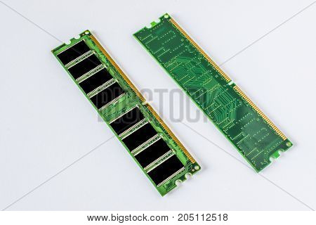 Green DDR RAM memory modules on a white background