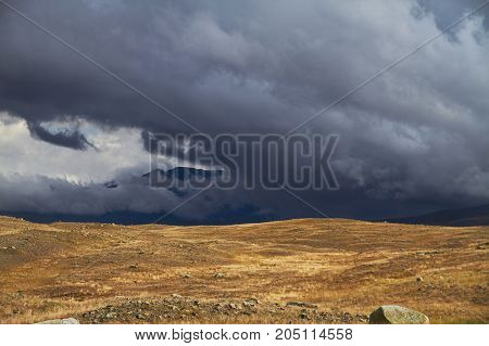 Clouds Over The Steppe Open Spaces, Storm Clouds Over The Hills. The Ukok Plateau In The Altai. Fabu