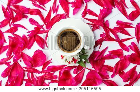 Cup Of Coffee Surrounded By Flower Petals