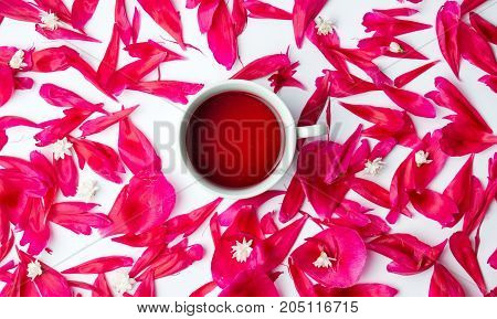 Cup Of Tea Surrounded By Flower Petals