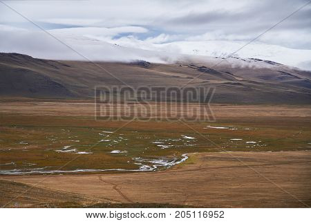 Cold Cloudy Weather In The Steppe Area. The Ukok Plateau Of Altai. Fabulous Cold Landscapes. Anyone