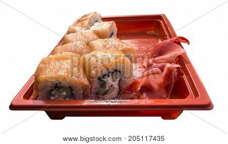 Rolls with salmon and pickled ginger on a red tray isolated on white background.