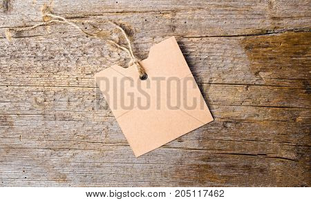 Empty Label Card On Rustic Wooden Background