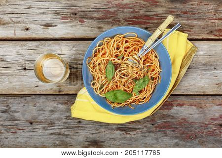 Traditional Italian Pasta With Tomato Sauce And Basil And White Wine In A Glass