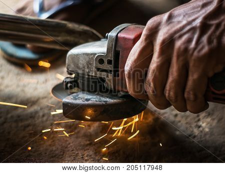 Hand Of Man With Steel Cutter Tool Blurred On Black Background