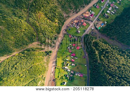 Beautiful nature landscape aerial view of the village in the Carpathian mountains. Top view. From above