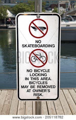 A no skateboarding and no bike lock warning sign