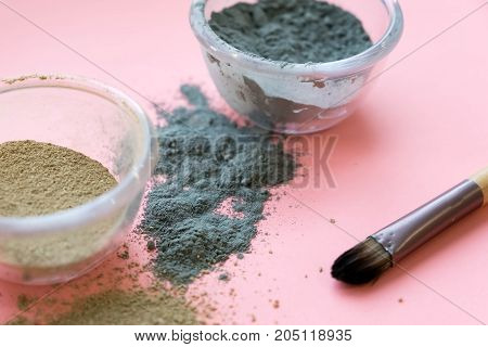bowl of black clay mask with brush at home skin care.