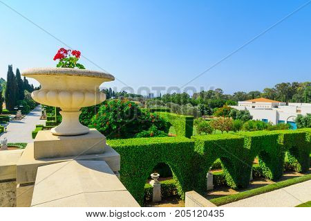 ACRE, ISRAEL - SEPTEMBER 18, 2017: Decorative flowerpot and a view of the Bahai gardens in Acre (Akko) Israel