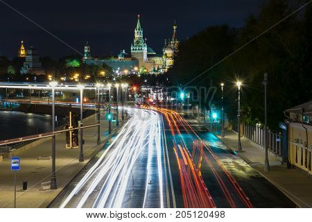 Street to kremlin in moscow at night blurred car lights long exposure