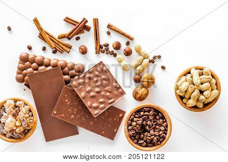 Ingredients for chocolates on white background top view.