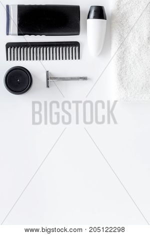 Men's shaving. Tools and cosmetics on white background top view.