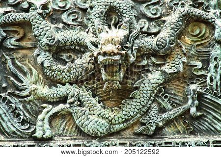 A Chinese dragon sculpture looking at the viewer.