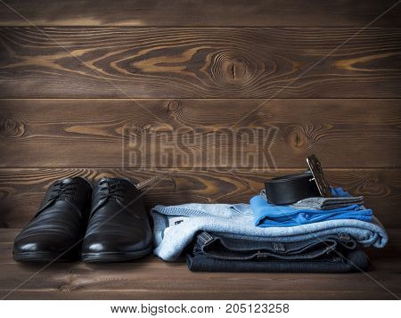 Casual clothes on wooden background. Side view
