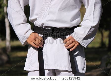 Tie a black belt and preparing for a practice