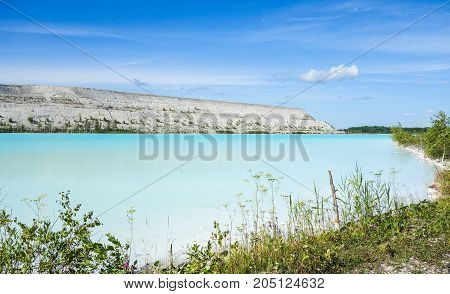 Alkaline lake with industrial toxic wasteland area