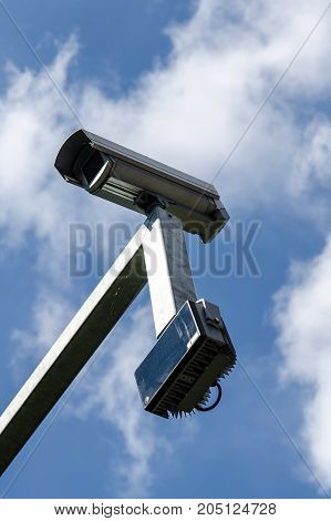 surveillance monitoring security camera with blue sky
