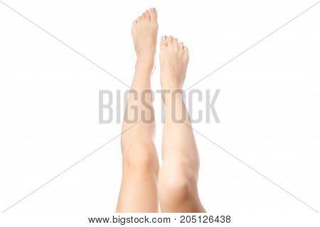 Beautiful female legs and on white background isolation