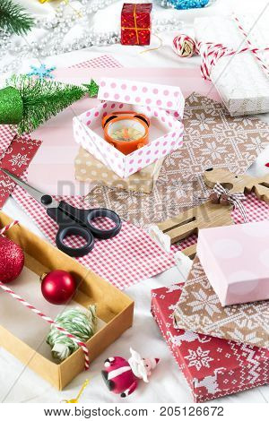 Christmas background. Creative hobby. Manufacturing of festive boxes made of handmade paper, new year
